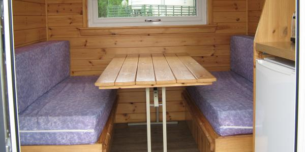Seating and dining area inside a little lodge