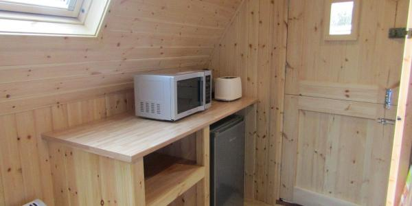 The kitchen area inside a glamping star pod at Barnsoul