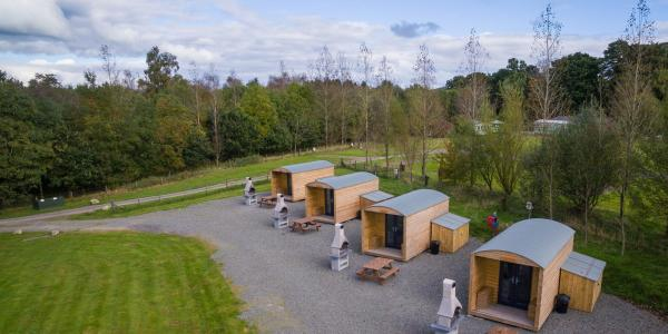 Row of glamping bothies at Barnsoul
