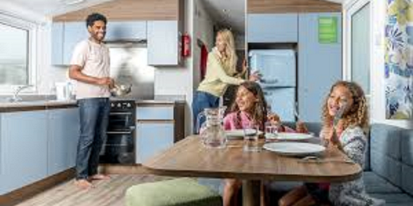 A family enjoying their static caravan holiday home at Barnsoul
