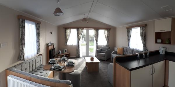 The living area of a static caravan holiday home at Barnsoul