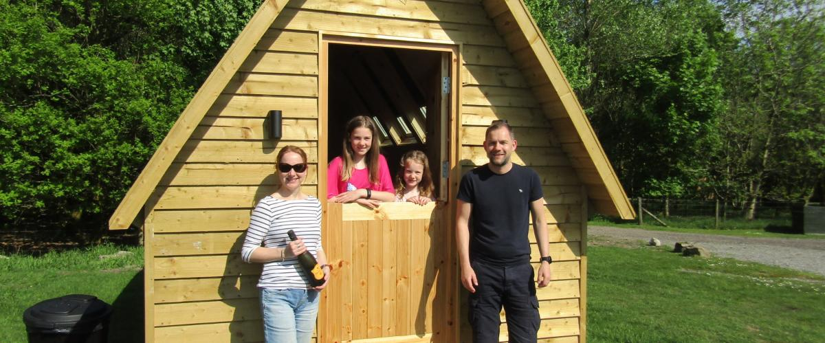 Family staying at a glamping star pod at Barnsoul