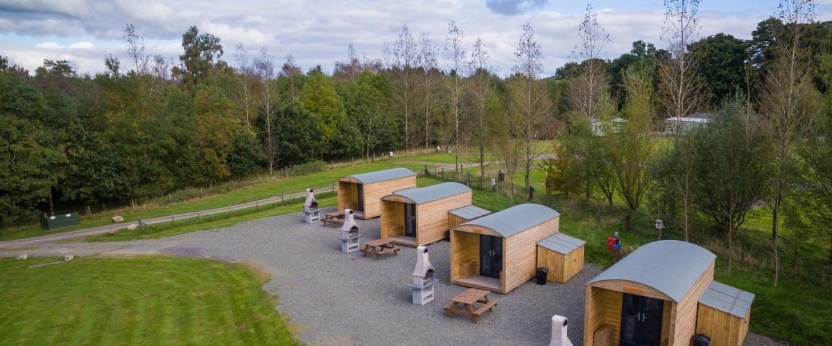 A row of glamping bothies at Barnsoul Caravan Park near Dumfries in south Scotland
